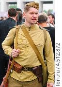 Купить «Советский солдат в форме образца Великой Отечественной войны», эксклюзивное фото № 4512872, снято 9 мая 2012 г. (c) Алёшина Оксана / Фотобанк Лори