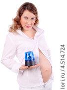 Купить «Беременная женщина в белой одежде держит на ладони синюю мигалку, белый фон», фото № 4514724, снято 6 февраля 2012 г. (c) Losevsky Pavel / Фотобанк Лори