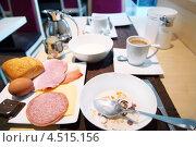 Купить «Питательный завтрак: мюсли с молоком, колбаса, сыр, яйца, кофе», фото № 4515156, снято 13 февраля 2012 г. (c) Losevsky Pavel / Фотобанк Лори