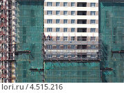 Купить «Фасадные работы новостройки», фото № 4515216, снято 28 мая 2011 г. (c) Losevsky Pavel / Фотобанк Лори
