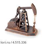 Купить «Металлический сувенир в виде нефтяного насоса-качалки», фото № 4515336, снято 23 октября 2011 г. (c) Losevsky Pavel / Фотобанк Лори