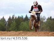Купить «Мотоциклист в полёте на трассе мотокросса», фото № 4515536, снято 4 июня 2011 г. (c) Losevsky Pavel / Фотобанк Лори