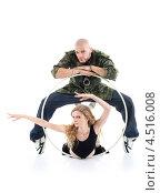 Купить «Рэпер стоит над гимнасткой и держит руки на обруче», фото № 4516008, снято 13 сентября 2011 г. (c) Losevsky Pavel / Фотобанк Лори