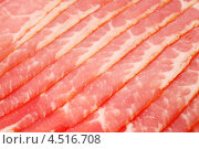 Купить «Красное мясо, нарезанное на тонкие порции, крупным планом», фото № 4516708, снято 4 ноября 2011 г. (c) Losevsky Pavel / Фотобанк Лори