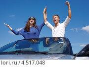 Купить «Счастливые молодой человек и девушка стоят в кабриолете, подняв руки, летом на фоне синего неба», фото № 4517048, снято 12 июня 2011 г. (c) Losevsky Pavel / Фотобанк Лори