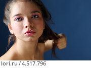 Купить «Портрет юной девушки с темными волосами на синем фоне», фото № 4517796, снято 12 ноября 2011 г. (c) Losevsky Pavel / Фотобанк Лори