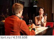 Купить «Элегантная молодая пара в ресторане. Девушка красит губы», фото № 4518608, снято 2 февраля 2012 г. (c) Losevsky Pavel / Фотобанк Лори