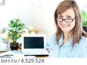 Купить «Девушка в очках в кабинете с нетбуком», фото № 4529524, снято 10 мая 2010 г. (c) Wavebreak Media / Фотобанк Лори