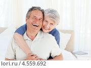 Купить «Радостная пожилая пара смотрит в камеру», фото № 4559692, снято 30 октября 2010 г. (c) Wavebreak Media / Фотобанк Лори