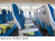 Купить «Пассажирский салон самолета с креслами», фото № 4561524, снято 8 апреля 2013 г. (c) Кекяляйнен Андрей / Фотобанк Лори