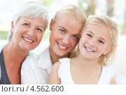 Купить «Красивые бабушка, дочка и внучка позируют на камеру», фото № 4562600, снято 1 ноября 2010 г. (c) Wavebreak Media / Фотобанк Лори