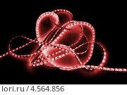 Купить «Красная светодиодная лента на черном фоне», фото № 4564856, снято 18 марта 2012 г. (c) Абышев А.А. / Фотобанк Лори