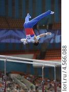 Купить «Эмин Гарибов выполняет упражнения на брусьях на Чемпионате Европы по спортивной гимнастике», фото № 4566088, снято 21 апреля 2013 г. (c) Stockphoto / Фотобанк Лори