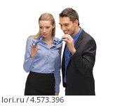 Купить «Молодой человек и девушка в офисной одежде светят ручными фонариками», фото № 4573396, снято 17 ноября 2012 г. (c) Syda Productions / Фотобанк Лори