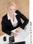 Купить «Красивая молодая девушка-бухгалтер в офисе», фото № 4577408, снято 14 июня 2012 г. (c) Андрей Попов / Фотобанк Лори