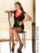 Купить «Темноволосая девушка с бокалом вина сидит на стуле в кафе», фото № 4611452, снято 1 мая 2012 г. (c) Сергей Сухоруков / Фотобанк Лори