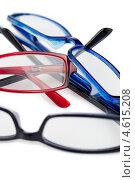Купить «Очки с цветными пластиковыми оправами», фото № 4615208, снято 16 марта 2011 г. (c) Wavebreak Media / Фотобанк Лори