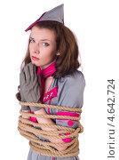 Купить «Девушка в костюме стюардессы перевязана канатом и сложила руки в мольбе», фото № 4642724, снято 1 февраля 2013 г. (c) Elnur / Фотобанк Лори