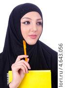 Купить «Молодая мусульманка с книгой и ручкой на белом фоне», фото № 4643056, снято 10 апреля 2013 г. (c) Elnur / Фотобанк Лори