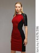 Купить «Стильная молодая женщина в красном платье с темными полосами по бокам», фото № 4676596, снято 17 ноября 2012 г. (c) Syda Productions / Фотобанк Лори