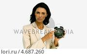 Купить «Businesswoman angrily pointing to the time», видеоролик № 4687260, снято 16 июля 2019 г. (c) Wavebreak Media / Фотобанк Лори