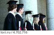 Купить «Graduates in line», видеоролик № 4702716, снято 5 апреля 2020 г. (c) Wavebreak Media / Фотобанк Лори