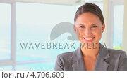 Купить «The camera pans across to a smiling woman», видеоролик № 4706600, снято 17 июля 2019 г. (c) Wavebreak Media / Фотобанк Лори