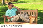 Купить «Handsome man using his  phone outdooors», видеоролик № 4710940, снято 2 июля 2020 г. (c) Wavebreak Media / Фотобанк Лори