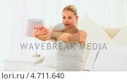 Купить «Blonde woman doing yoga», видеоролик № 4711640, снято 26 марта 2019 г. (c) Wavebreak Media / Фотобанк Лори
