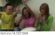 Купить «Group of Young Adults Watching Television», видеоролик № 4727504, снято 29 марта 2020 г. (c) Wavebreak Media / Фотобанк Лори