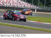Купить «Автомобиль SEAT команды ALL-INKL.COM Munich Motorsport проходит вираж на Чемпионате мира по шоссейно-кольцевым гонкам FIA WTCC на трассе Moscow Raceway», фото № 4742576, снято 7 июня 2013 г. (c) Николай Винокуров / Фотобанк Лори