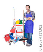Профессиональная уборка. Мужчина с тележкой моющих средств. Стоковое фото, фотограф Андрей Попов / Фотобанк Лори