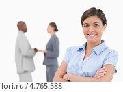 Купить «Счастливая предпринимательница стоит перед коллегами сложив руки на груди», фото № 4765588, снято 8 ноября 2011 г. (c) Wavebreak Media / Фотобанк Лори