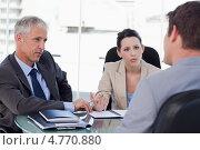 Купить «Бизнесмены ведут переговоры с заказчиком», фото № 4770880, снято 10 ноября 2011 г. (c) Wavebreak Media / Фотобанк Лори