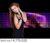 Купить «Красивая светловолосая женщина с микрофоном на цветном фоне», фото № 4776028, снято 27 февраля 2013 г. (c) Андрей Попов / Фотобанк Лори