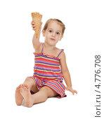 Купить «Маленькая девочка в полосатом сарафане ест мороженое», фото № 4776708, снято 11 июля 2010 г. (c) Syda Productions / Фотобанк Лори