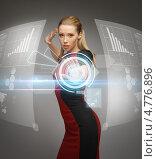 Купить «Молодая женщина работает с виртуальным экраном будущего поколения», фото № 4776896, снято 17 ноября 2012 г. (c) Syda Productions / Фотобанк Лори