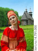 Купить «Девушка в русском народном костюме на фоне деревянной церкви», фото № 4791000, снято 23 июня 2013 г. (c) ElenArt / Фотобанк Лори