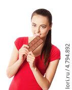 Купить «Девушка ест шоколад», фото № 4794892, снято 26 мая 2019 г. (c) Майя Крученкова / Фотобанк Лори