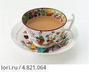 Купить «Изысканная чашка чая на блюдце», фото № 4821064, снято 20 июля 2019 г. (c) Food And Drink Photos / Фотобанк Лори