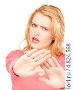 Купить «Девушка показывает рукой жест стоп», фото № 4824568, снято 28 марта 2010 г. (c) Syda Productions / Фотобанк Лори