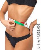 Купить «Стройная девушка с черном белье измеряет талию сантиметром», фото № 4852608, снято 12 июня 2012 г. (c) Syda Productions / Фотобанк Лори