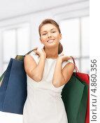 Купить «Эмоциональная счастливая девушка с покупками в пакетах после удачного шопинга», фото № 4860356, снято 28 августа 2011 г. (c) Syda Productions / Фотобанк Лори