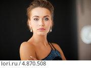 Купить «Красивая молодая женщина с бриллиантовыми серьгами в ушах на темном фоне», фото № 4870508, снято 17 марта 2013 г. (c) Syda Productions / Фотобанк Лори