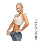 Купить «Стройная девушка в джинсах большого размера», фото № 4870524, снято 23 марта 2013 г. (c) Syda Productions / Фотобанк Лори
