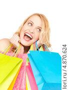 Купить «Восторженная девушка с покупками в пакетах», фото № 4870624, снято 28 марта 2010 г. (c) Syda Productions / Фотобанк Лори