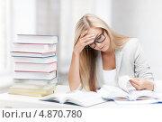 Купить «Студентка в очках готовится к экзаменам», фото № 4870780, снято 30 марта 2013 г. (c) Syda Productions / Фотобанк Лори