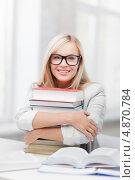 Купить «Счастливая студентка в очках в обнимку с книгами», фото № 4870784, снято 30 марта 2013 г. (c) Syda Productions / Фотобанк Лори