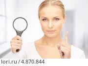 Купить «Красивая молодая женщина с лупой», фото № 4870844, снято 30 октября 2010 г. (c) Syda Productions / Фотобанк Лори