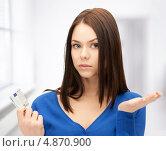 Купить «Расстроенная девушка с евро в руках», фото № 4870900, снято 2 апреля 2011 г. (c) Syda Productions / Фотобанк Лори